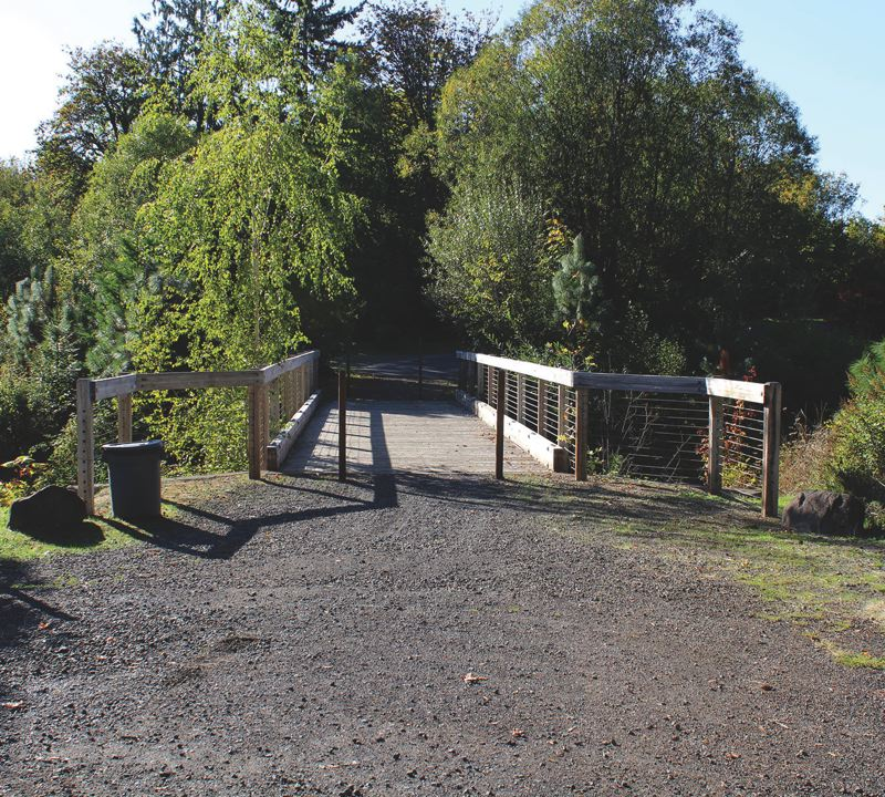 SPOKESMAN PHOTO: CLAIRE GREEN - If the City changes the community garden and future dog parks access to Kolbe Lane, the City will have to retrofit the existing Boeckman Creek Bridge for vehicle use.