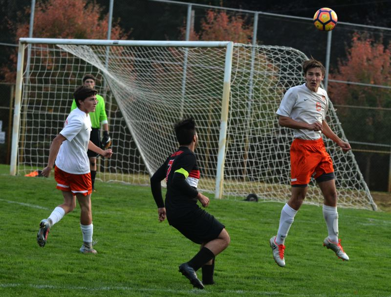 SPOTLIGHT PHOTO: JAKE MCNEAL - Indians junior Blake Peterson (6) leaps for a header.