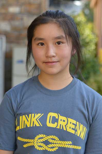 TIDINGS PHOTO: CLARA HOWELL - Aliris Tang, 15, volunteers at the Wilsonville Public Library and is starting a Chinese language and culture exhibit at the library that is dedicated to the school district's Chinese sister school, No. 26 Middle School.