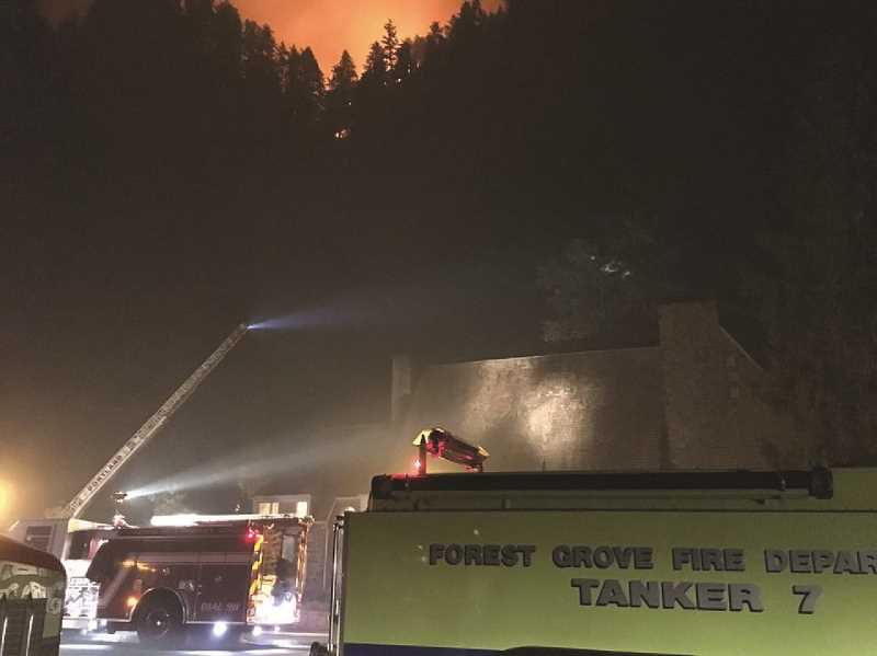 COURTESY PHOTO: FOREST GROVE FIRE DEPARTMENT - A tanker from the Forest Grove Fire Department helps protect Multnomah Falls from the Eagle Creek fire in September. Crew members from across Washington County are back in action — this time in California.