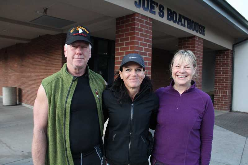 REVIEW PHOTO: SAM STITES - Mike Cavanaugh (left), Teresa Wymetalek and Kathren Cavanaugh pose for a photo after an early morning boot camp session.