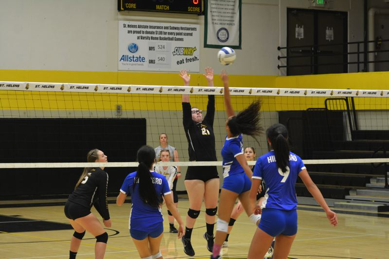 SPOTLIGHT PHOTO: JAKE MCNEAL - Lions sophomore middle blocker Brynn Austin (21) leaps to defend against a shot.