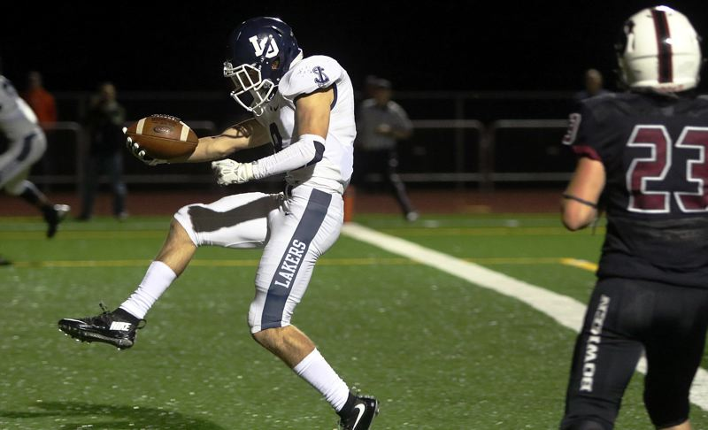PAMPLIN MEDIA GROUP PHOTO: DAN BROOD - Lake Oswego senior Alex Bassett runs into the end zone for the first of his two touchdowns in the win at Sherwood.