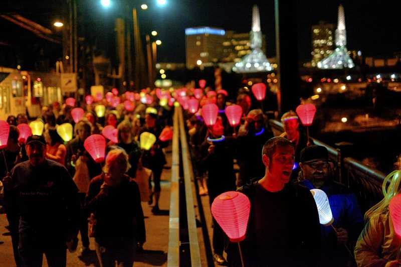 PHOTO COURTESY OF THE LEUKEMIA & LYMPHOMA SOCIETY - Saturday's Light the Night event will begin at the Oregon Museum of Science & Industry before crossing over the Willamette River via the Tilikum Crossing pedestrian bridge. Colored lanterns will be lit by participants to signify their relationship to deadly blood cancers, whether they've lost someone (red), are currently fighting cancer (yellow) or have beaten their disease (white).