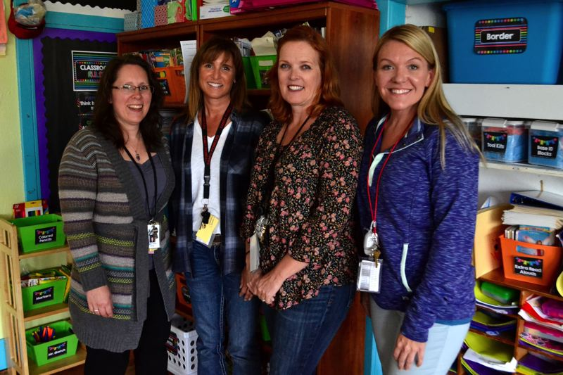 POST PHOTO: BRITTANY ALLEN - Krista Frank, Kathy Rasmussen, Donna Cole and Mindy Jensen are educational assistants at Sandy Grade School.