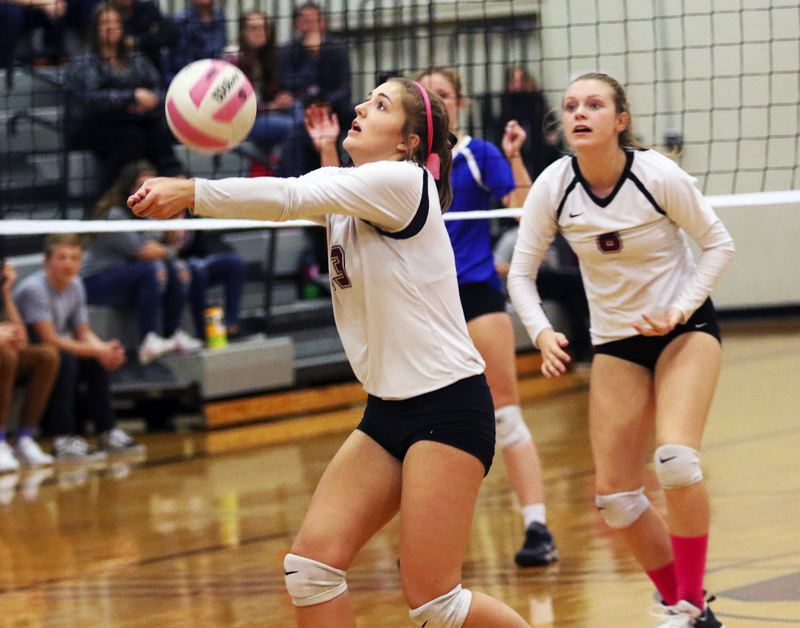 DAN BROOD - Sherwood High School sophomore Allison Fiarito keeps the ball in play during the Lady Bowmen's five-set win over Newberg on Tuesday.