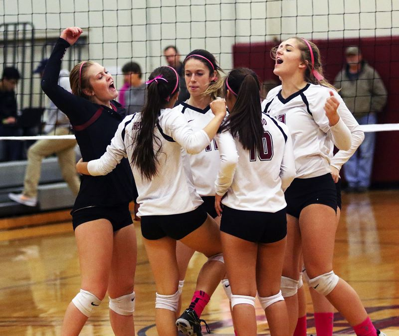 DAN BROOD - The Lady Bowmen celebrate during the five-set win over Newberg.