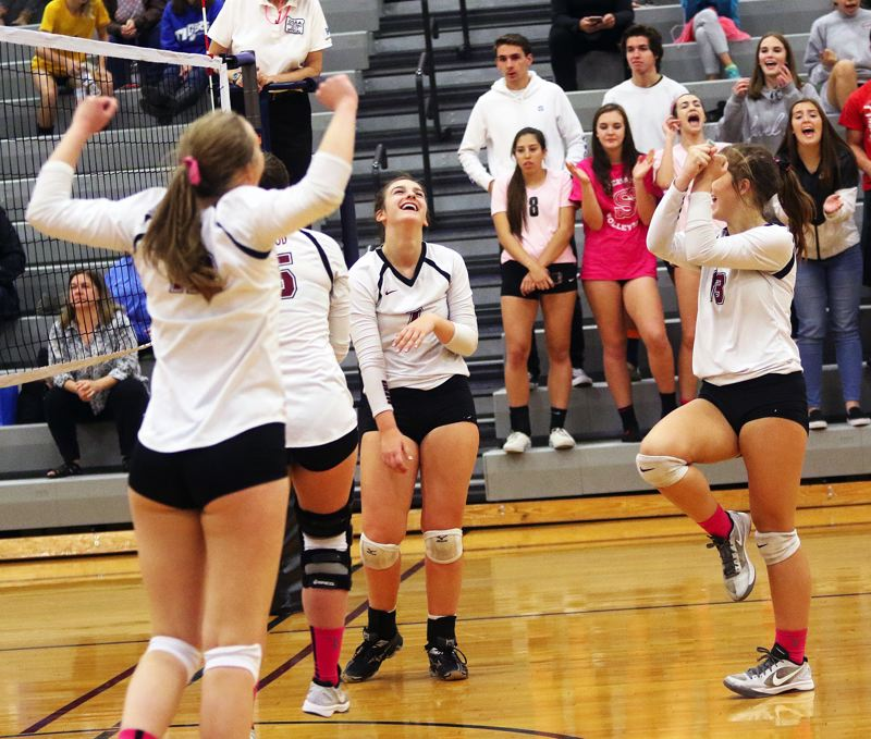 DAN BROOD - The Sherwood volleyball team is all smiles following the final point in the win over Newberg.