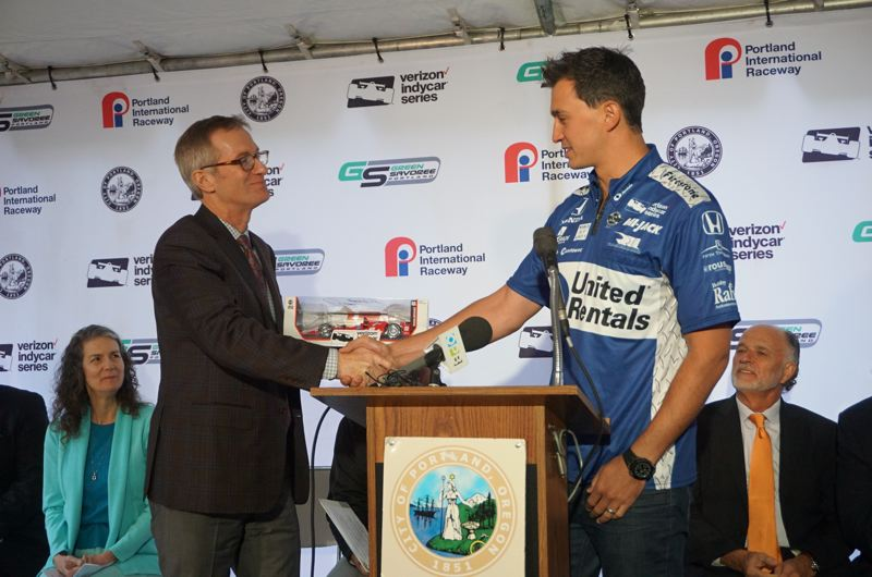 PORTLAND TRIBUNE: JEFF ZURSCHMEIDE - Mayor Ted Wheeler shook IndyCar racer Graham Rahal's hand at Friday's press conference as Commissioner Amanda Fritz and promoter Kim Green looked on.