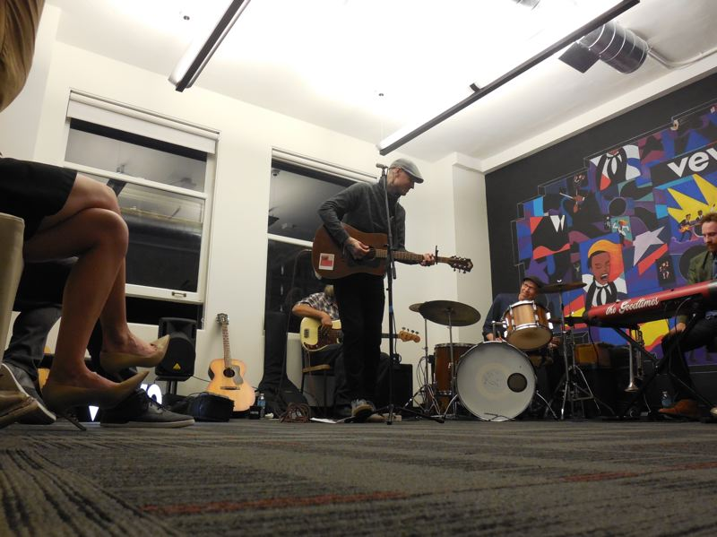 COURTESY: VEVO; PAMPLIN MEDIA GROUP: JOSEPH GALLIVAN - Local rocker/troubador Joshua English played in the Vevo lobby to give a bit of pep to the occasion. The Portland office is mostly made up of  Vevos engineering team.
