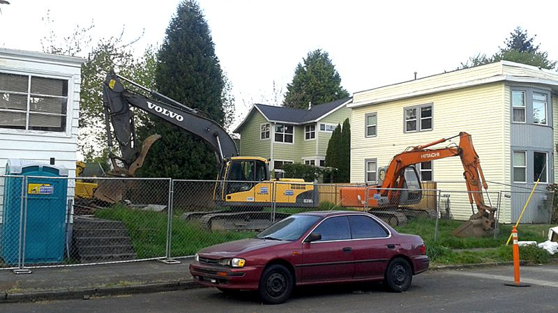 COURTESY PHOTO: PORTLAND CHRONICLE - Builder Peter Kusyk began demolition of a Northeast Portland church in April. Kusyk's Firenze Development has faced off with neighbors of a Northeast Porltand bungalow because of concerns about lead in the demolition dust.