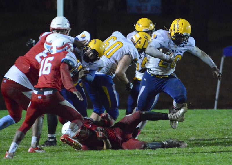 OUTLOOK PHOTO: DAVID BALL - Barlow running back Jobi Malary breaks out of a crowd during the first half of the Bruins 21-6 win at Centennial on Thursday night.