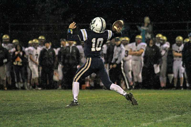 NEWS-TIMES PHOTO: WADE EVANSON - Banks' Hayden Vandehey throws a pass during the Braves' game against Astoria Oct. 12 at Banks High School.