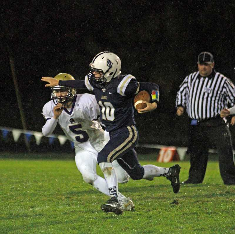 NEWS-TIMES PHOTO: WADE EVANSON - Banks' Hayden Vandehey scrambles from the pocket during the Braves' game against Astoria Oct. 12 at Banks High School.