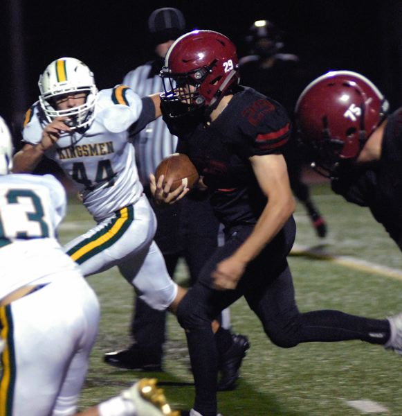 SANDY POST: MATT RAWLINGS - Sandy running back Kael Schilperoort breaks into the Putnam secondary.
