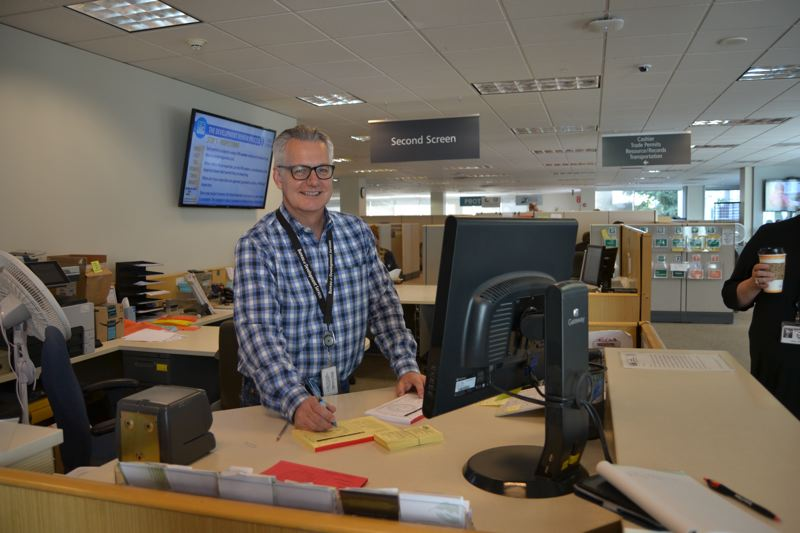 PAMPLIN MEDIA GROUP: JULES ROGERS - The first screen desk is manned by Kenton Kullby, who assesses what a customer is looking for, and which route they should take to get their permits.