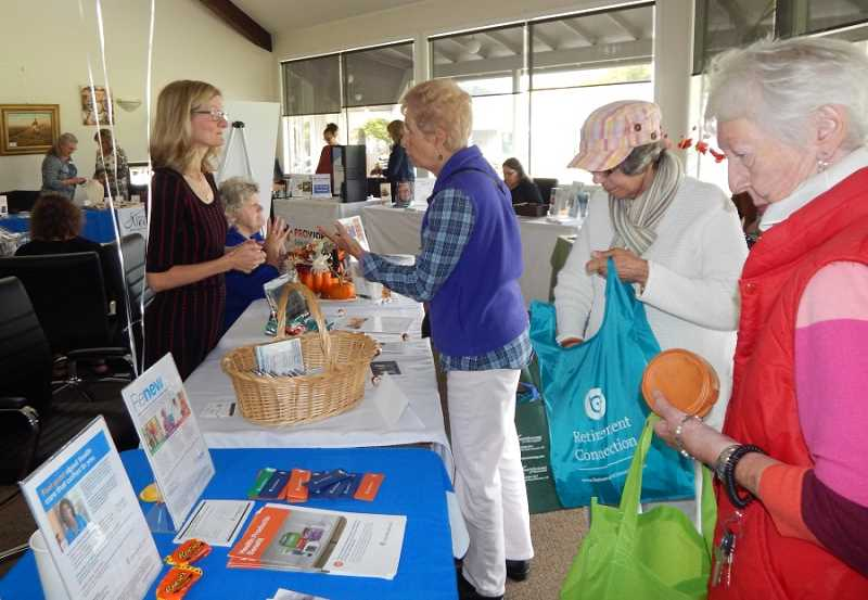 BARBARA SHERMAN - At the King City Expo, guests' Retirement Connection bags filled up as they went through several rooms full of vendors' tables in the King City Clubhouse and colleted pamphlets and samples.
