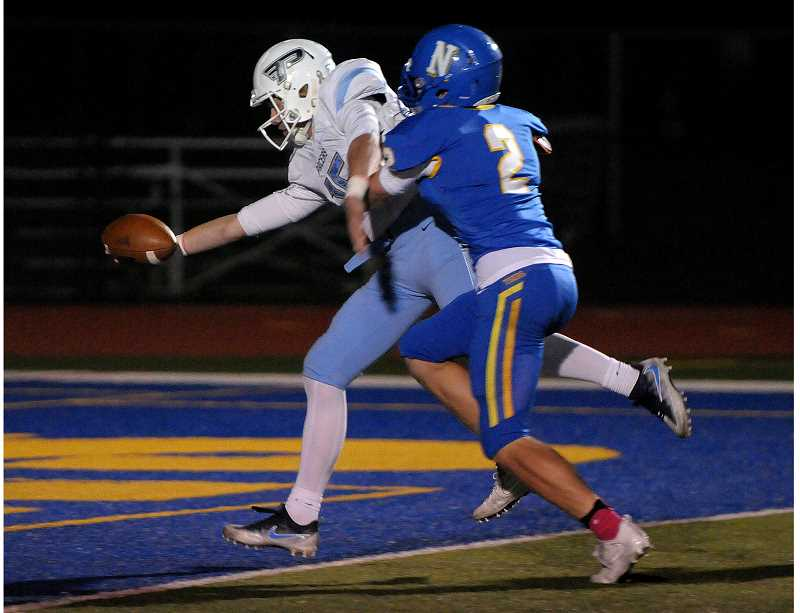 SETH GORDON - Lakeridge quarterback Charlie Mayes extends the all over the goal line to complete a 24-yard touchdown run during the Pacers' 36-0 road win over Newberg Friday night.