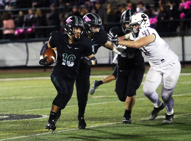 DAN BROOD - Tigard sophomore Max Lenzy looks for more yardage during Friday's game with Sherwood.