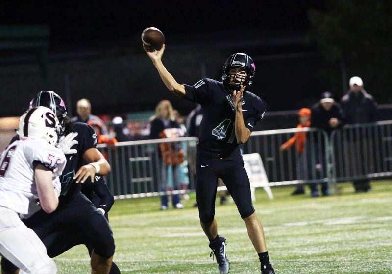 DAN BROOD - Tigard freshman quarterback Drew Carter throws a pass during Friday's game with Sherwood.