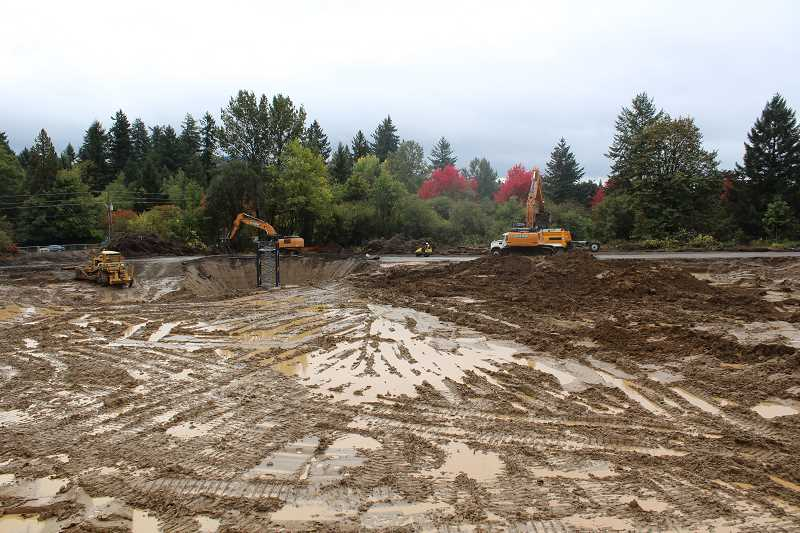 REVIEW PHOTO: ANTHONY MACUK - Todd Construction crews are already digging out and grading the site at Boones Ferry Road and Kruse Way for The Springs at Lake Oswego, and a tower crane is scheduled to be installed this week.