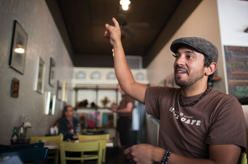 PAMPLIN MEDIA GROUP: JAIME VALDEZ - Lawrence Garcia, a server and shift lead at Gigis Café, welcomes changes that saw a 10 percent surcharge replace tipping. He feels it is fairer to the back of the house (dishwashers, cooks), and profit sharing encourages staff loyalty.