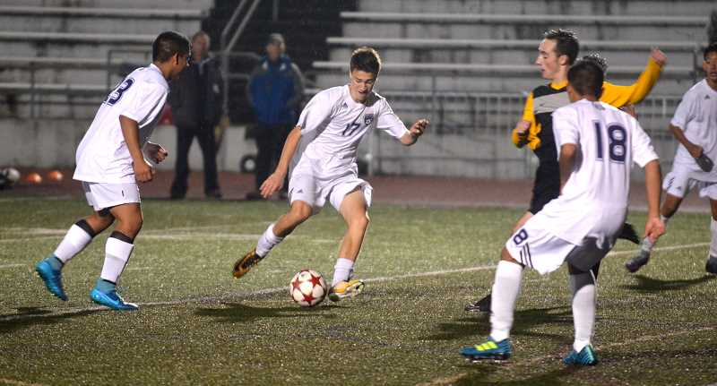 SPOKESMAN PHOTO: TANNER RUSS - Junior Luke Spears battles into the Lions half of the field in the second 40 minutes. The Wildcats defeated St. Helens 6-1 on Tuesday, Oct. 10.