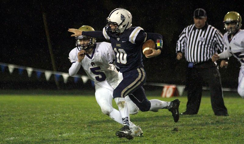 PAMPLIN MEDIA GROUP PHOTO: WADE EVANSON - Banks quarterback Hayden Vandehey runs to dayight during his team's 41-0 home win over Astoria on Thursday.