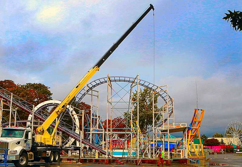 DAVID F. ASHTON - Carefully, piece-by-piece, the crew from WBF Construction Services dismantled Oaks Parks Looping Thunder, which perhaps may yet thrill riders at a new home.