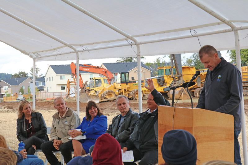 SUBMITTED PHOTO - Far right, Scott Archer, NCPRD director, speaks at the ribbon-cutting event on Sept. 26, as all five Clackamas County commissioners look on.