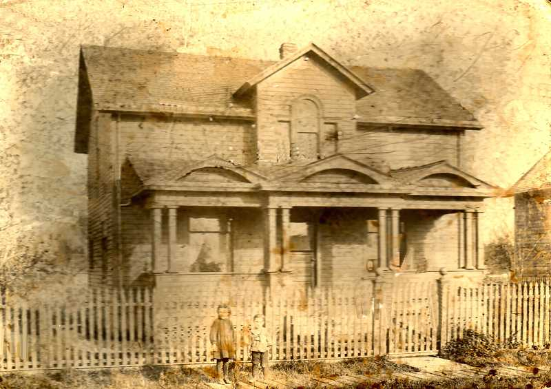 COURTESY OF GENE SCRUTTON - This house at 1837 S.E. Harold Street, the oldest one in the Midway Annex at the north end of todays Westmoreland, was constructed with a very unusual front porch roof. This photo was probably taken sometime around 1902, and two small boys are visible against the front picket fence.