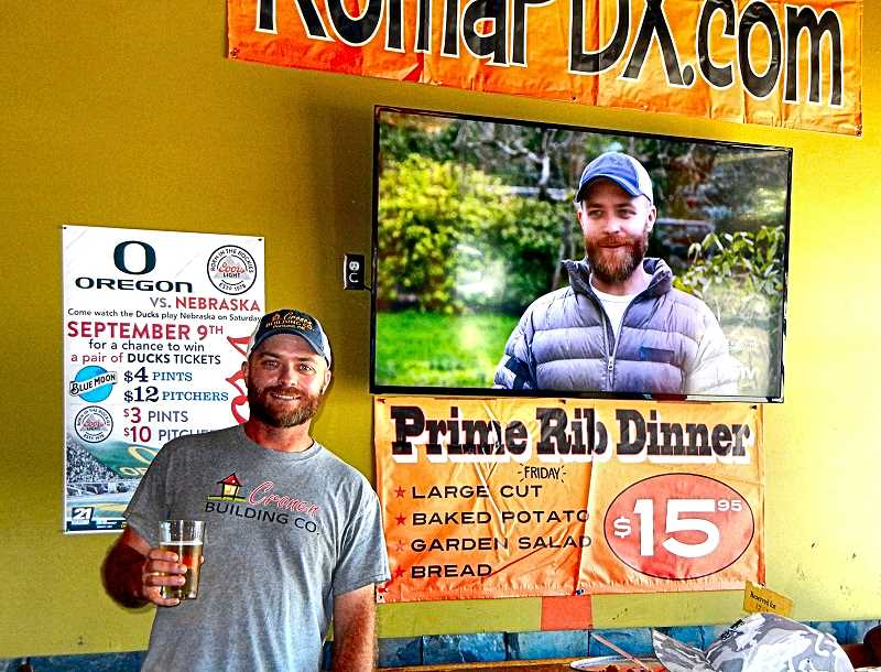 ELIZABETH USSHER GROFF - Kelbe Cronen, here both on the screen and in person, at the showing of his HGTV TV episode at Woodstocks Pizza Roma this summer. He and his crew hold beersiness meetings every Friday to go over the weeks work, he says.