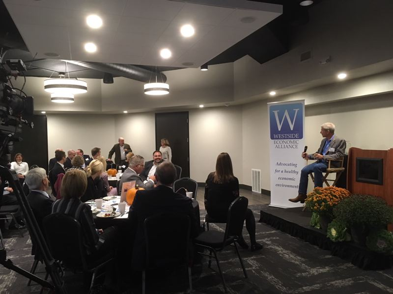 PAMPLIN MEDIA GROUP: PETER WONG - U.S. Rep. Kurt Schrader, D-Ore., responds to a question from Beaverton Mayor Denny Doyle at a breakfast of the Westside Economic Alliance on Tuesday, Oct. 17, at the Home Builders Association of Metropolitan Portland in Lake Oswego.