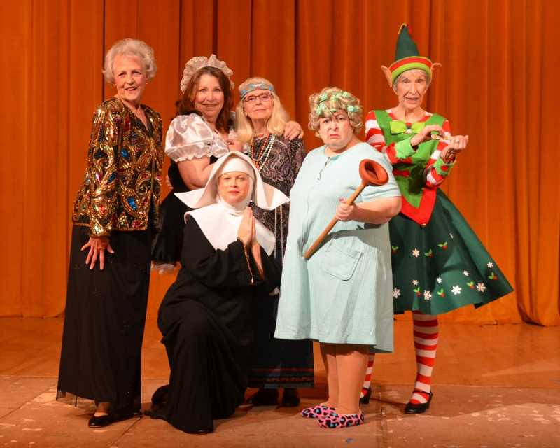 RON TENISON/NORTHWEST SENIOR THEATRE - What song could these costumed beauties possibly be singing? (From left) Only MaryAnn Routio, Areanne Lloyd, Joanne Breen (kneeling), Ann V. Lemomn, Jan Rosenthal and Myrl Svela know the truth.