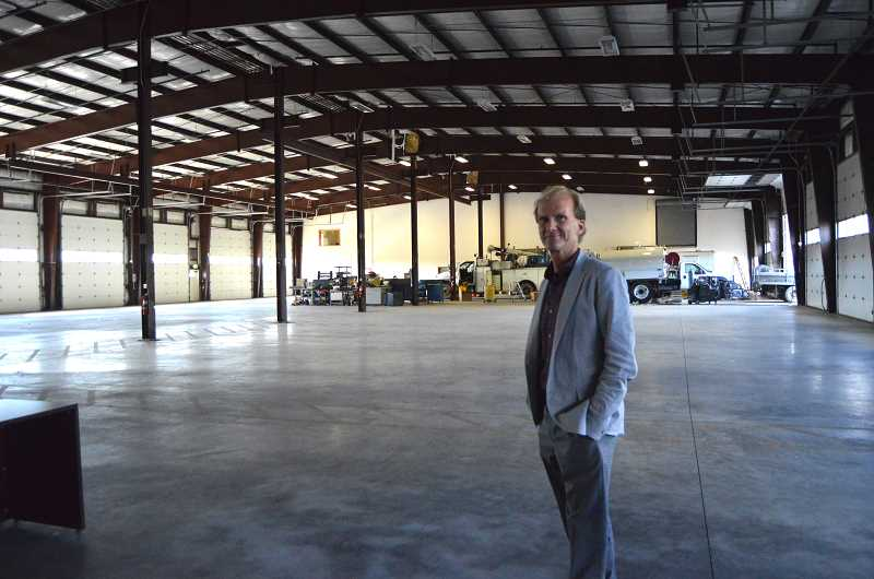 SPOTLIGHT PHOTO: COURTNEY VAUGHN - Mike Myers, OIT professor and OMIC executive, shows off warehouse space that will eventually house industrial machines and apprentice workers. Gov. Kate Brown on Thursday, Oct. 12, announced two new OMIC partners while on a trade mission to Japan.