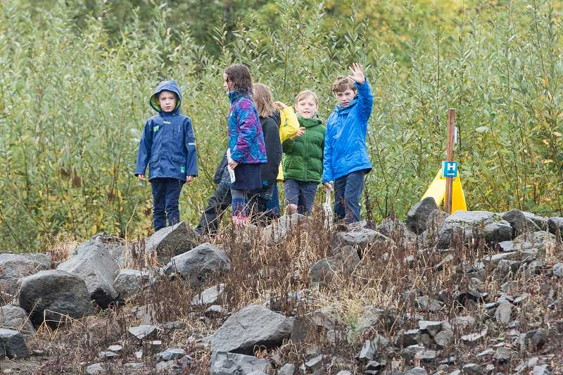HILLSBORO TRIBUNE PHOTO: CHRISTOPHER OERTELL - Children from the Le Monde French Immersion Public Charter School in Portland take a tour around Pintail Pond at Jackson Bottom Wetlands Preserve in Hillsboro, on Oct. 12.