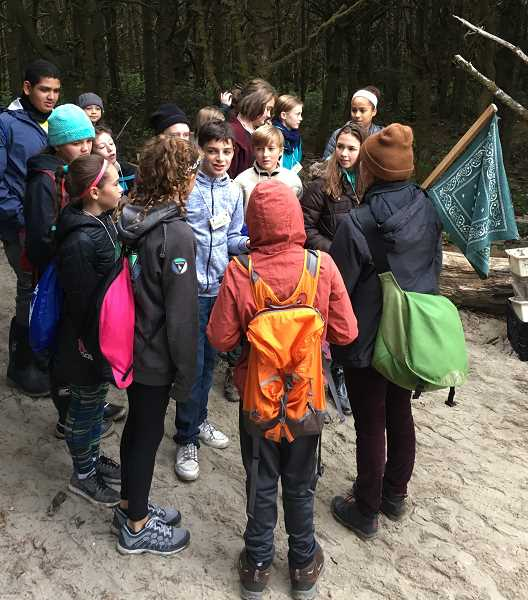 SUBMITTED PHOTO: CATHERINE MELTON - Lakeridge Junior High students gather for a group activity at Camp Magruder in Rockaway Beach. Field studies at Outdoor School are divided up into four categories: earth, forest, animals and water.