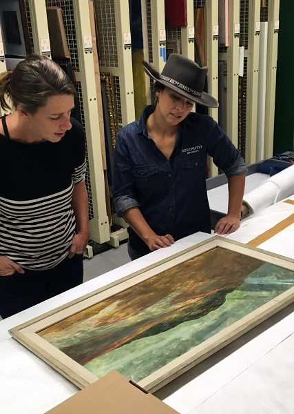 COURTESY: PORTLAND ART MUSEUM - Veronica Vega (right in hat), head brewer at Deschutes Brewery, muses over a 100-year-old painting of Black Butte, which inspired her special beer for the Nov. 4 'Pitchering Orego