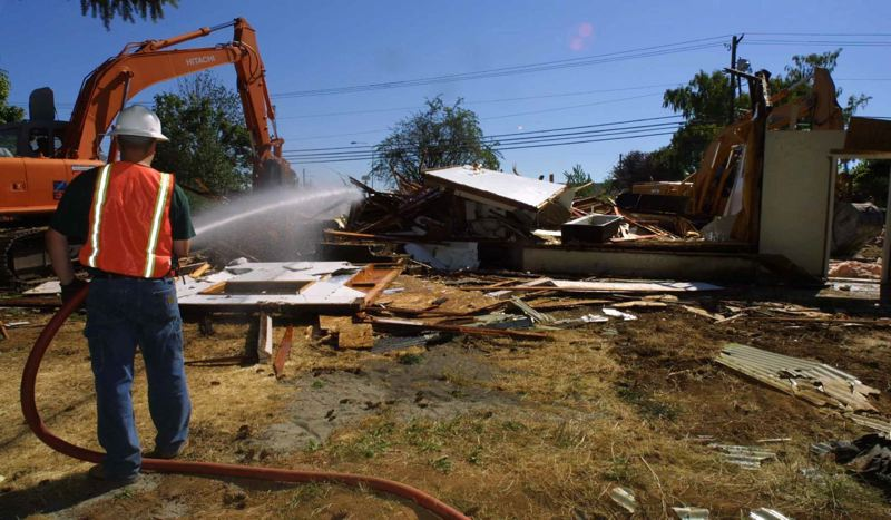 PAMPLIN MEDIA GROUP: FILE PHOTOS - When nearby residences are demolished, some neighbors fear toxins could be released —and had no way of checking on the DEQ or OSHA documents. Now, after SB871, theyll be able to request them directly from the City.