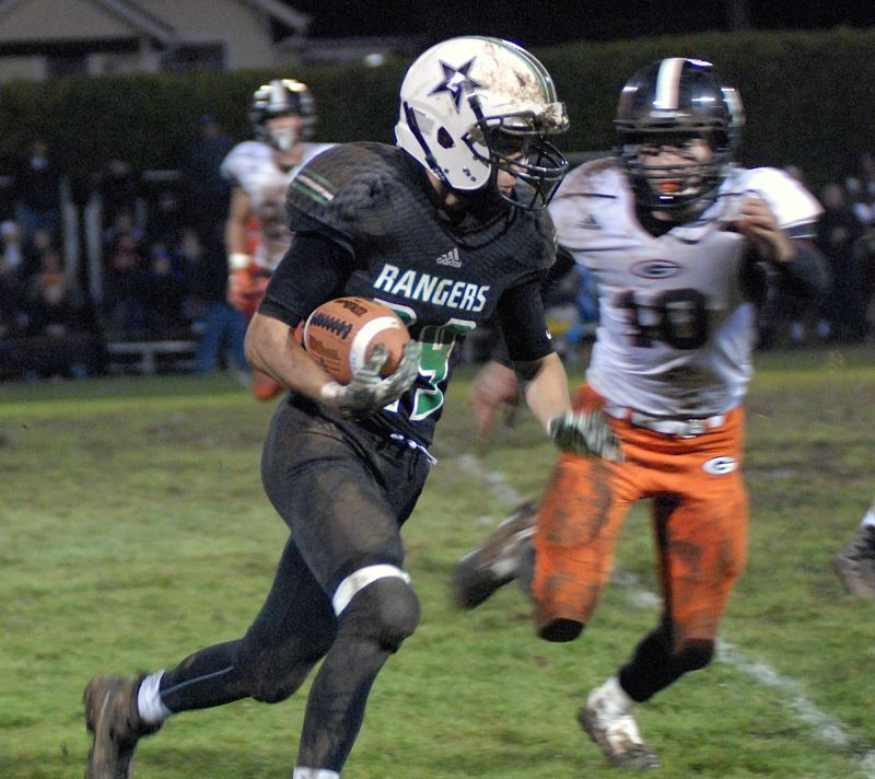 ESTACADA NEWS: MATT RAWLINGS - Estacada running back Logan Stamm runs for a first down.