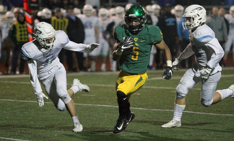 TIDINGS PHOTO: MILES VANCE - West Linn senior Ahmir McGee takes off for one of his two third-quarter touchdows during the Lions' 49-0 home win over Lakeridge on Friday.