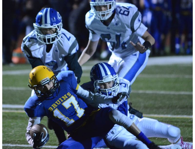 OUTLOOK PHOTO: DAVID BALL - Barlow receiver Cole Edmondson tumbles forward out of a crowd of Gresham tacklers to pick up a first down early in the Bruins 34-7 win Friday night. He made eight catches for 104 yards.