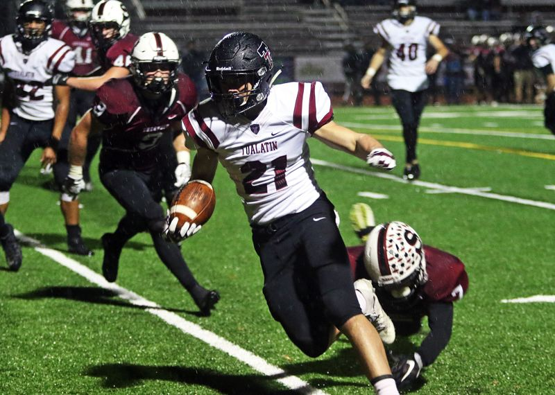 DAN BROOD - Tualatin sophomore Kainoa Sayre heads to the end zone during the third quarter of Friday's game.