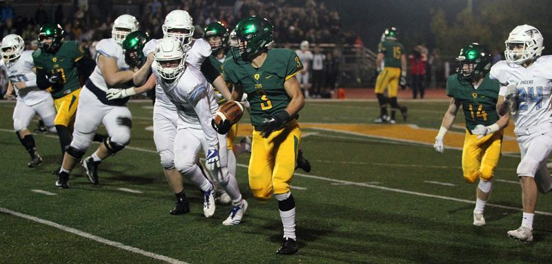 PAMPLIN MEDIA GROUP PHOTO: MILES VANCE - West Linn senior defensive back Cody Fretwell races past Lakeridge for the second of his two touchdowns on interception returns — this one measuring 56 yards — in his team's 49-0 home win on Friday.