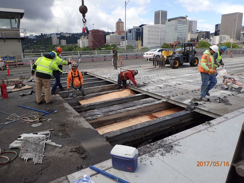 SUBMITTED: MULTNOMAH COUNTY - Hamilton Construction removes the old fiberglass deck panels.