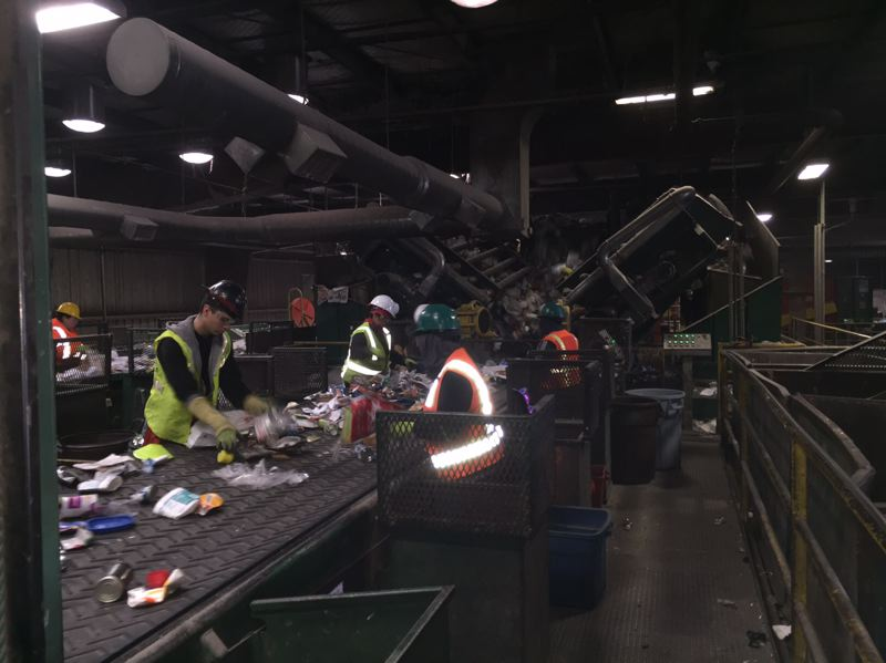 COURTESY FAR WEST RECYCLING  - Workers pull out improper items that don't belong in the recycling on a conveyor belt at Far West Recyclings Hillsboro plant.