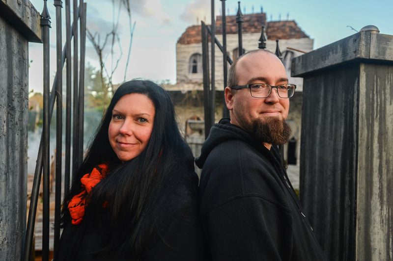 OUTLOOK PHOTO: JOSH KULLA - Becky Newman and Troy Crivellone are responsible for Witch Creek Cemetery, one of the most prominent Halloween haunts in East Multnomah County. Crivellone also publishes a local guide to Halloween displays.