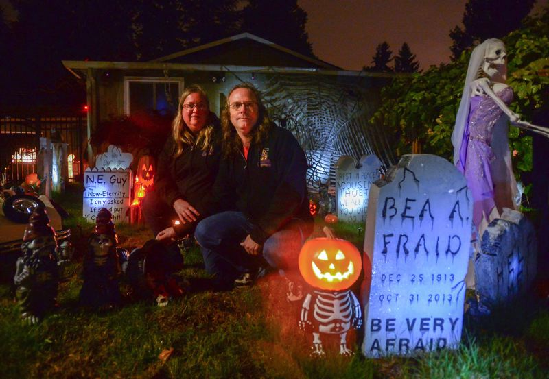 OUTLOOK PHOTO: JOSH KULLA - Karen Olsen and Scott Tangen of Southeast Portland have been showing off their Pumpkin Acres Halloween display for 10 years now. This year, it includes hundreds of pumpkins and an array of frightening apparitions.