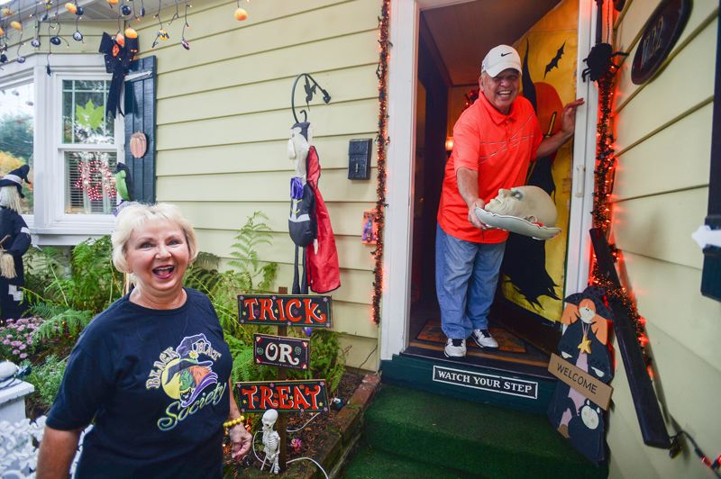 OUTLOOK PHOTO: JOSH KULLA - Linda and Rick Paz of Troutdale have been entertaining area residents for years with their colorful Halloween and Christmas displays. This year, the retired couple remains as ghoulish as ever as they prepare for trick or treaters.