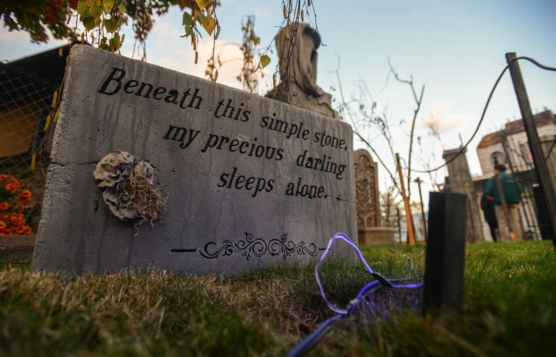 OUTLOOK PHOTO: JOSH KULLA - Witch Creek Cemetery, like other Halloween displays, features dark humor on its realistic tombstones.